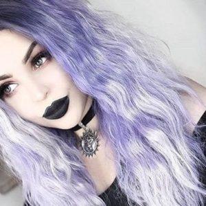 alternative model tavujeus wears a purple wig with black lipstick and hellaholics 90s velvet sun choker