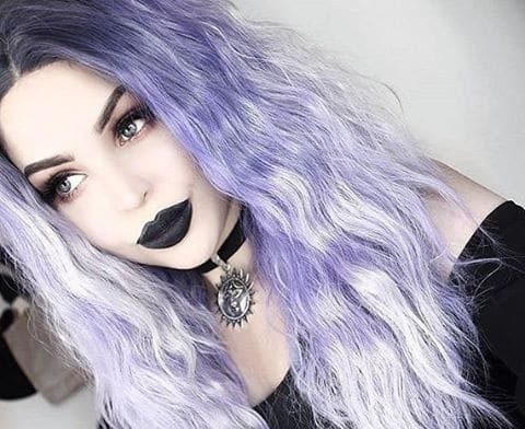 alternative model tavujeus wears a purple wig with black lipstick and hellaholics 90s velvet sun choker