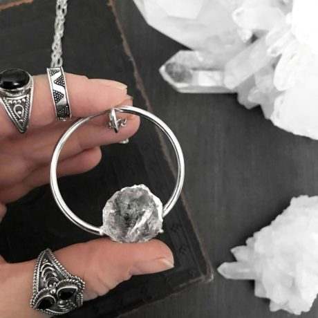 halo-clear-crystal-quartz-necklace-hand