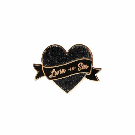 Sparkling black glitter pin in the shape of a heart