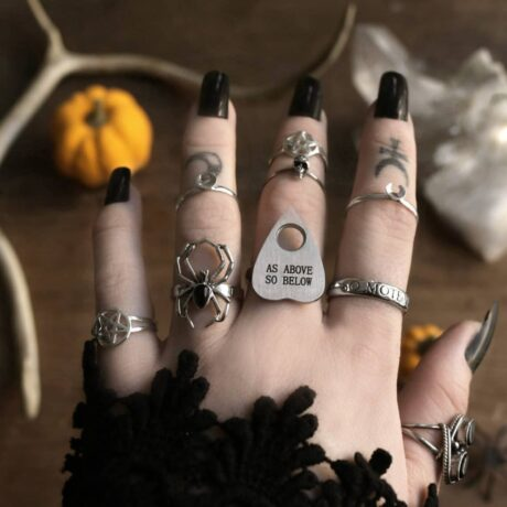Occult rings, black long nails and finger tattoos.