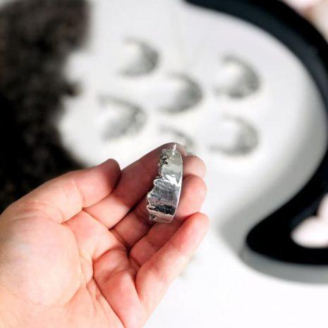 titanium-druzy-crescent-moon-necklace-hellaholics-hand-2