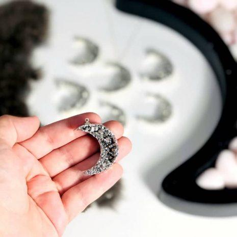 titanium-druzy-crescent-moon-necklace-hellaholics-hand-size