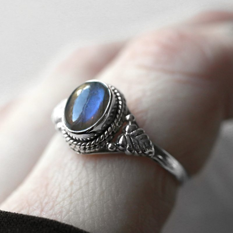 Close up photo on sterling silver ring with labradorite crystal stone.