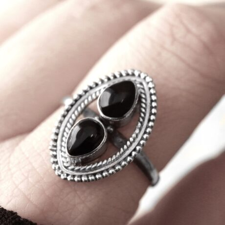 Sterling silver ring with 2 oval shaped pitch black onyx crystal stones.