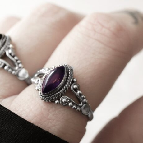 Sterling silver ring with an oval shaped purple amethyst crystal stone.