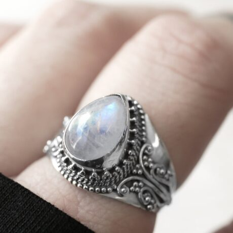 Close up photo of a silver moonstone crystal ring.