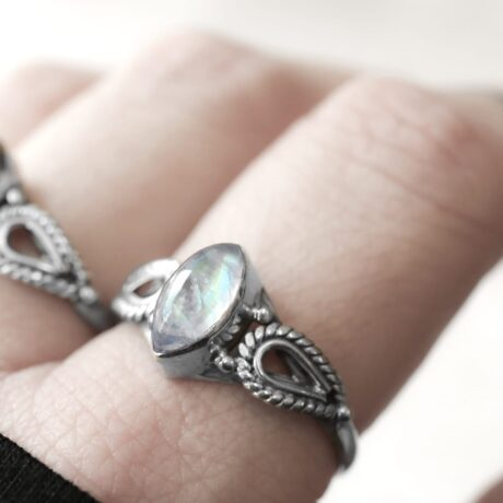 Silver ring with a milky white, blue moonstone crystal.